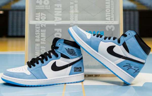 "Autographed by ""University Blue"" (University Blue) on Air Jordan 1 presented by Roy Williams, Michael Jordan"